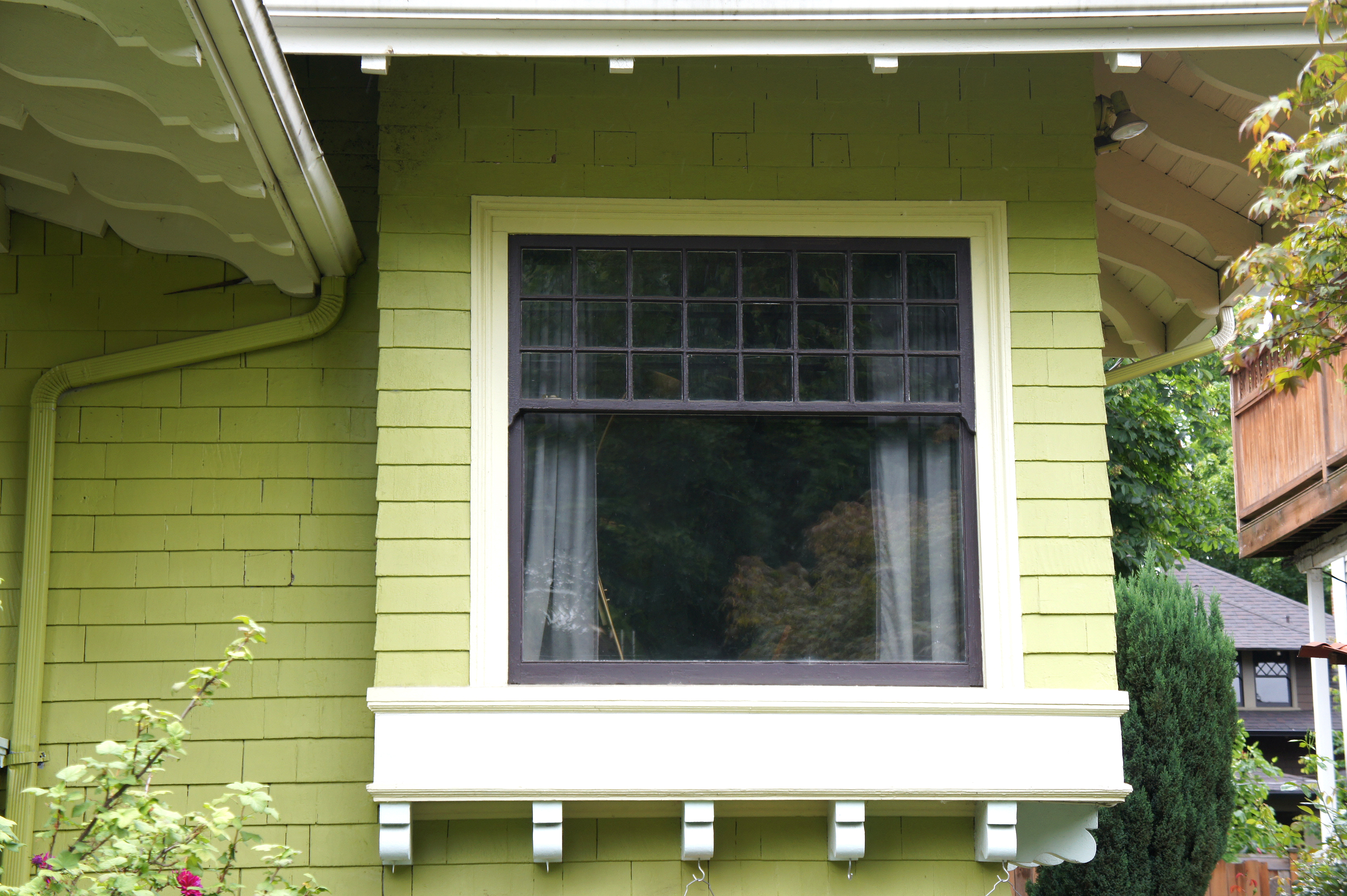 Indow preserving the charm of a craftsman bungalow for House window design from outside