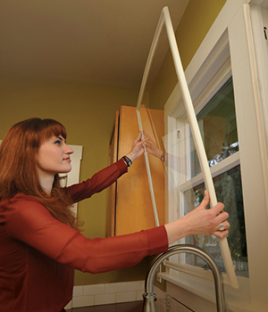 kristina installing an indow window