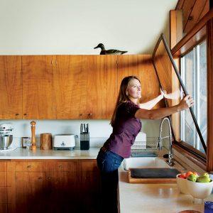 Karen installing an Indow insert.