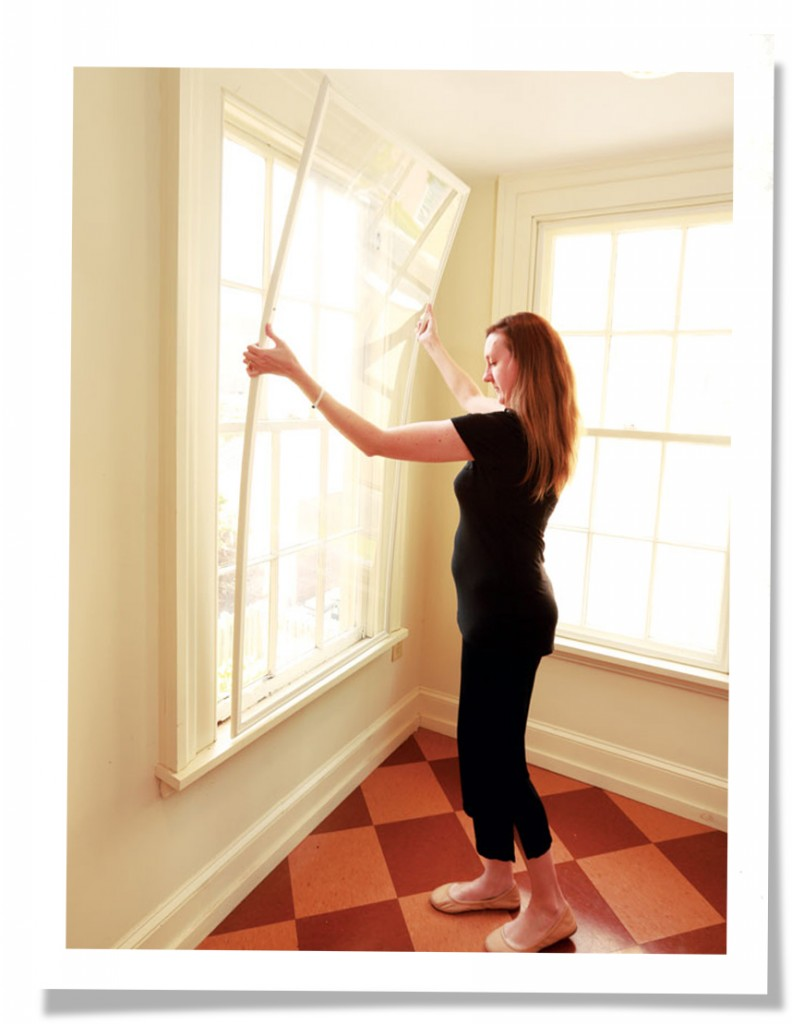 augusta woman placing indow in sunny window