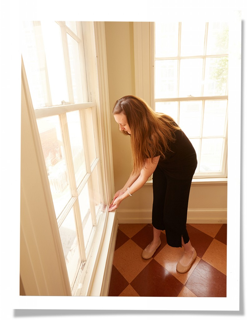 augusta woman pressing in indow sunny windows