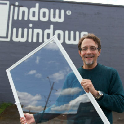 Indow CEO Sam holding a window insert