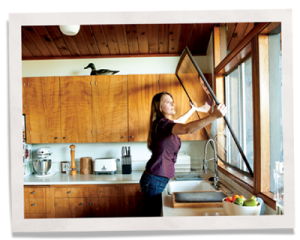woman installing indow insert for simple soundproofing in windows