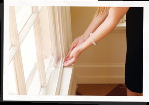 woman installing soundproof window insert