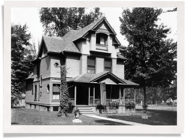 exterior view of home with queen anne windows