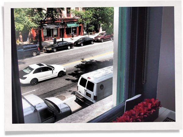 traffic outside a window with window insert installed as noise pollution solution