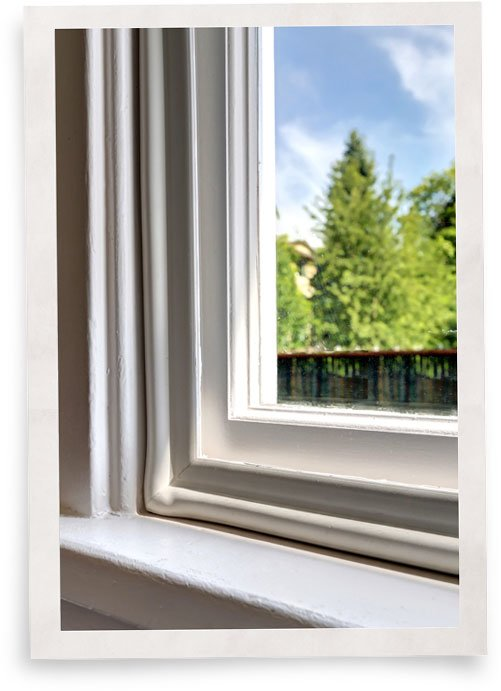 closeup of Indow window insert used for energy efficiency in historic home