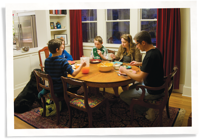 family eating next to window with Indow inserts, a window replacement alternative