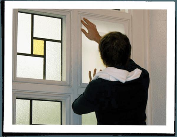 person installing indow window church storm windows
