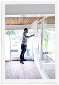 man installing window insulation inserts