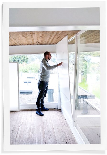 man installing window insert by pressing it into place