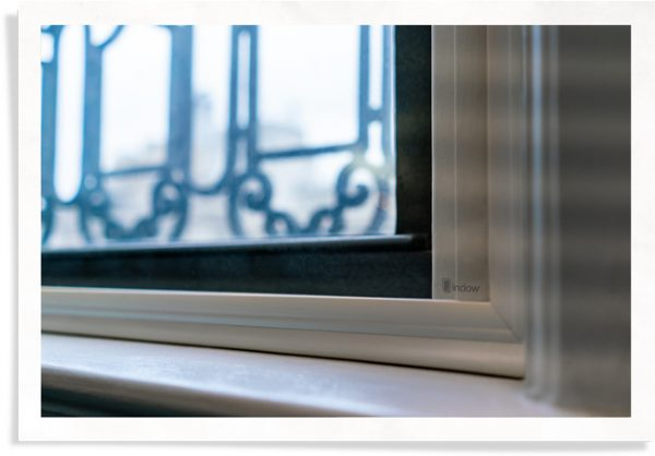 closeup of Indow window inserts in hotel window used for hotel guest complaints and resolutions to block noise