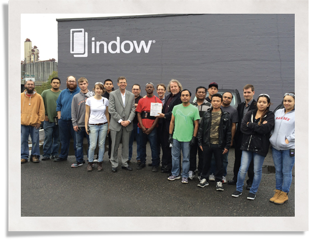 group of individuals outside a building: Indow clean practice in manufacturing