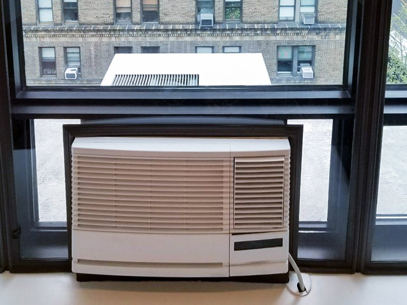 window insert installed around ac unit as an air quality solution