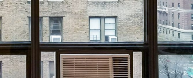 soundproof window air conditioner with window insert in large window