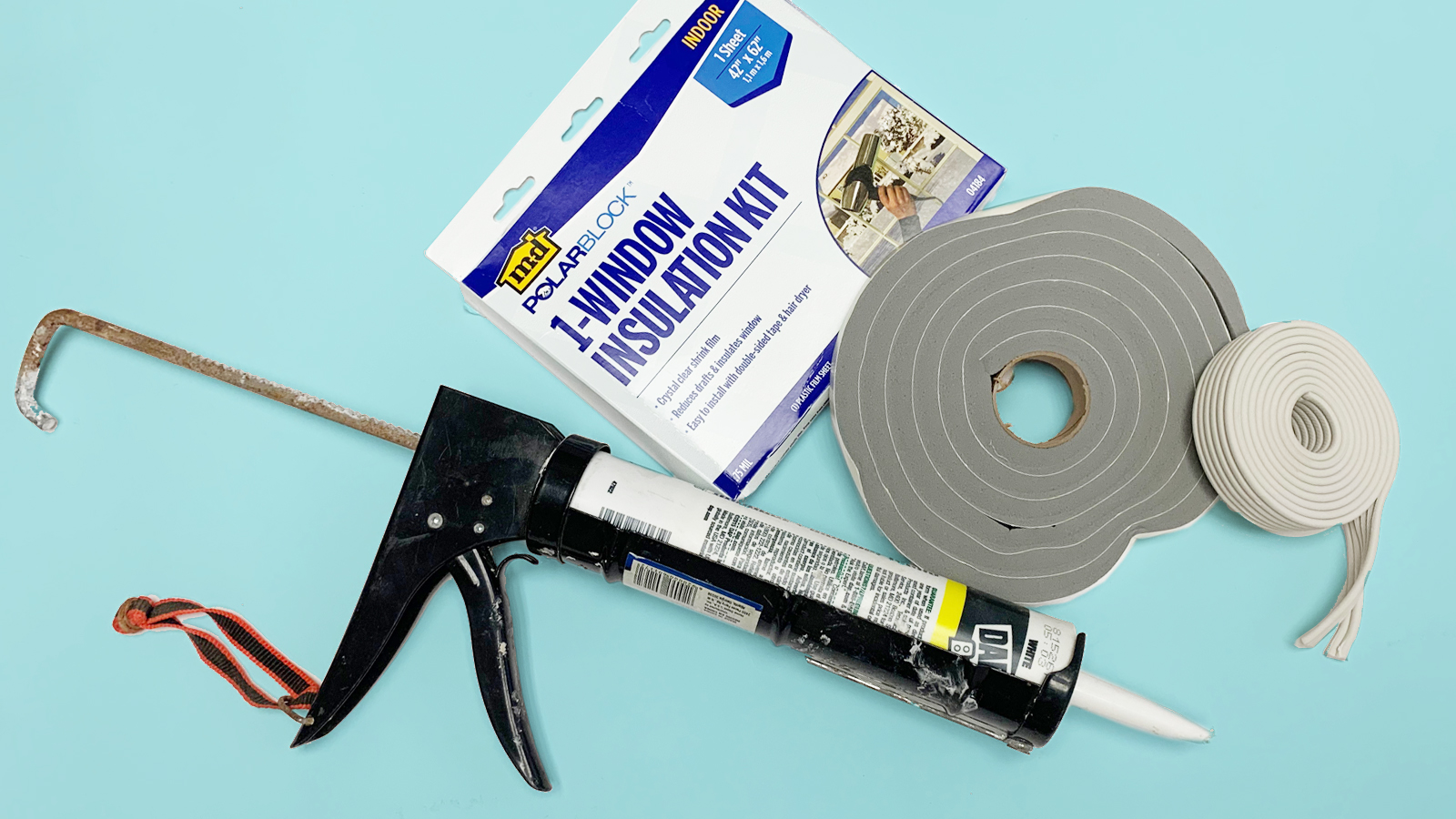 shrink-wrap kit, caulk gun, and weatherstipping all used to winterize windows