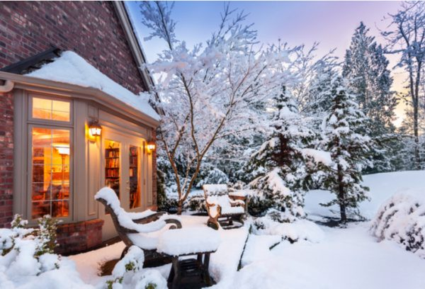 snow covered home kept warm because of tip: winterize your windows