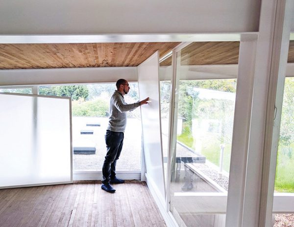 Man installing insert: Replacements better than window retrofits? It's window replacement myth