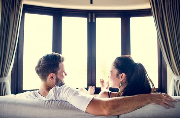 Couple in front of window: window energy efficiency myths debunked