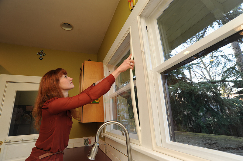 woman installing compression seal window insert