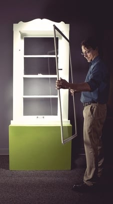 Indow CEO installing first window insert with compression seal