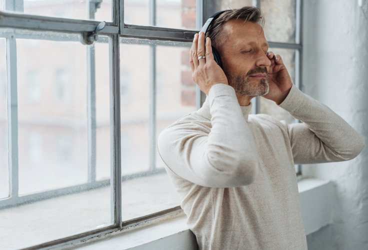 man using window inserts to prevent noise pollution