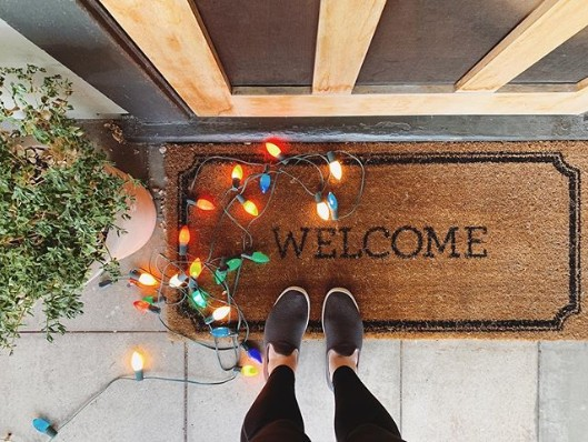 welcome mat for family visits with colored lights