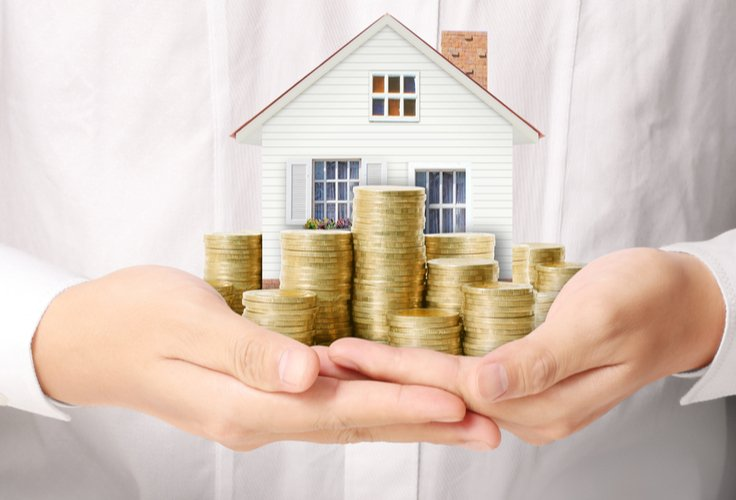 home with coins in front of it - increase home value with easy improvements