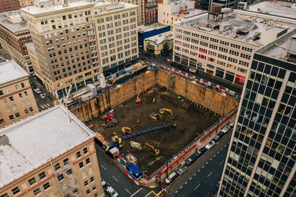 overhead shot of construction site with construction equipment