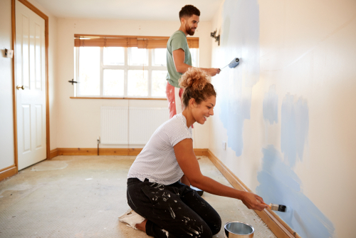 two people painting a room as a home improvement project during quarantine