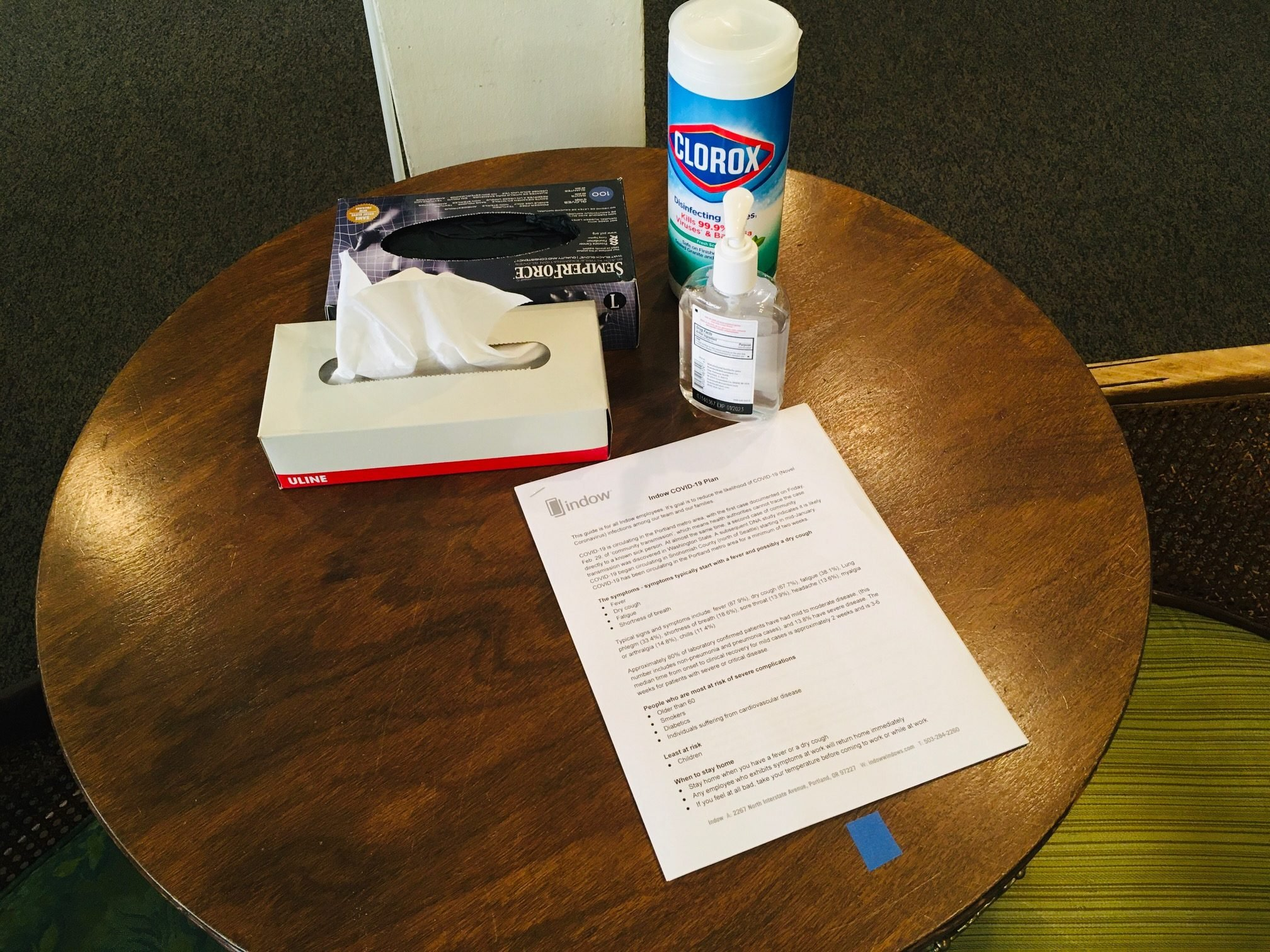 table with cleaning supplies and return to work COVID-19 mitigation plan