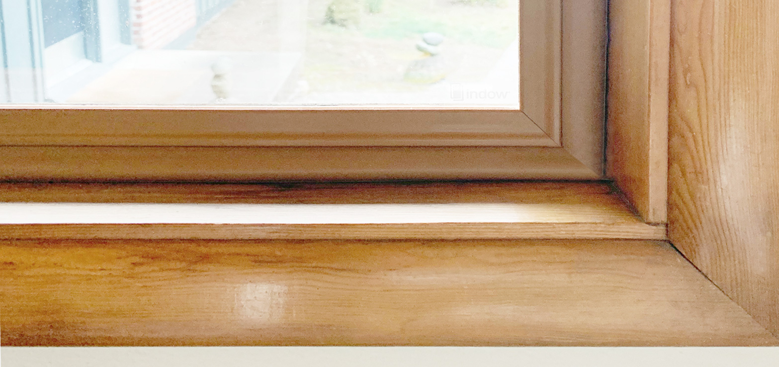 natural wood color tube Indow window insert in hand crafted wood window