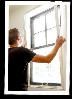 man installing interior window insert