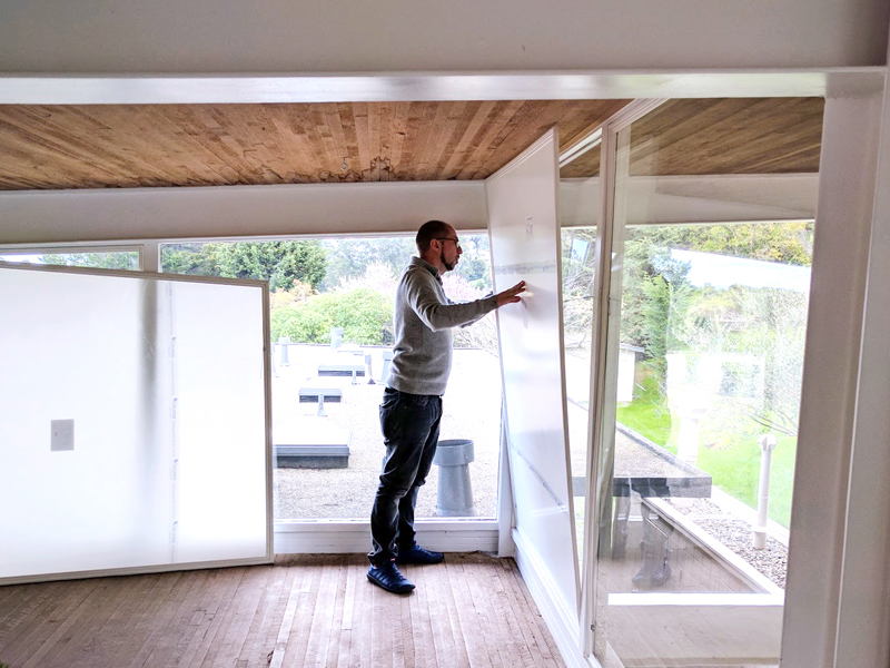 man installing window insert into one of 20,000 homes treated by Indow inserts