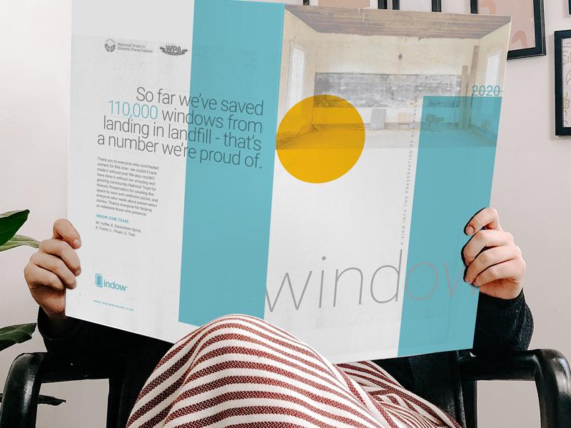 woman reading third edition of Window Zine