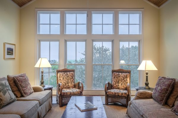 living room with large wall of windows with interior magnetic storm windows