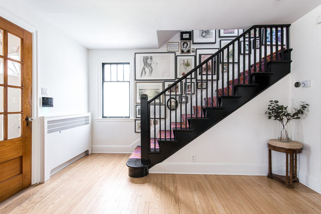 stairs with carpet and framed pictures lining stairway