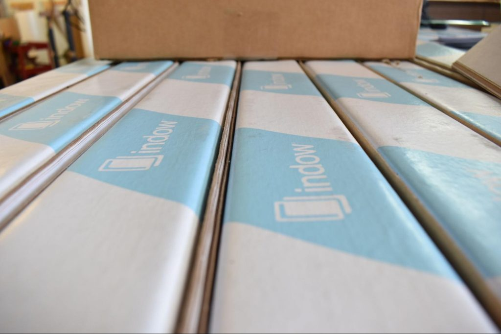 Close up of Indow window inserts packaged and ready to be shipped.