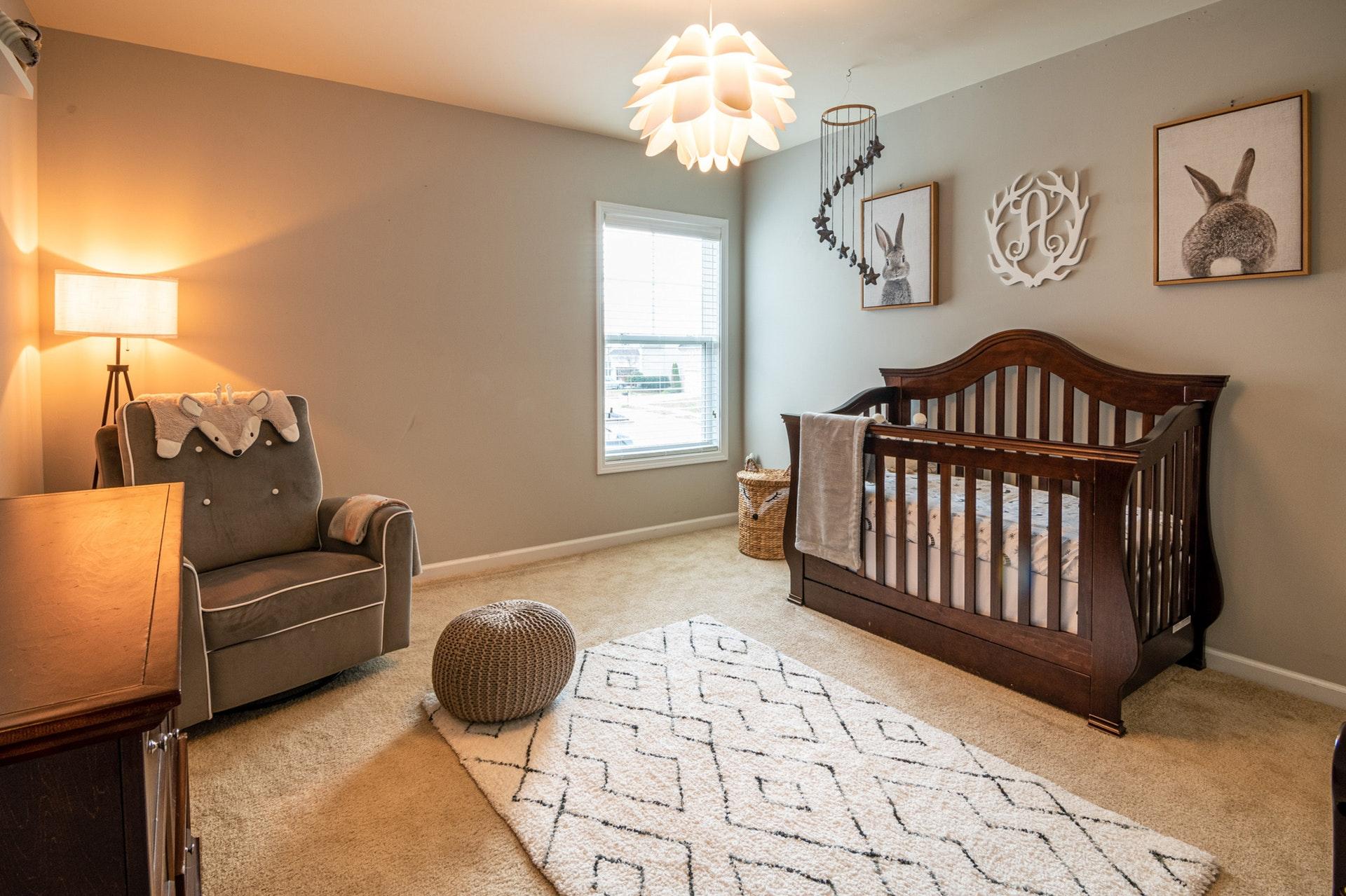 brown wooden baby crib near white wooden framed glass window