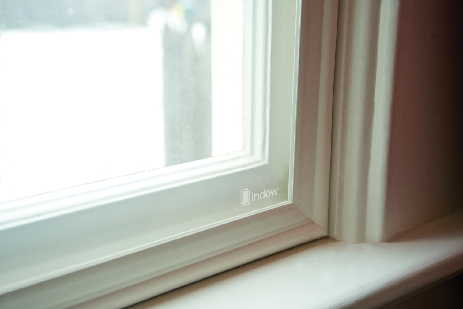 Frost-covered window with snow outside: window repair or replacement might not actually be necessary
