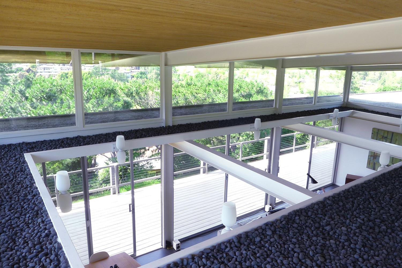 Case Study House #26: acrylic Indow inserts help block draft through the large glass windows